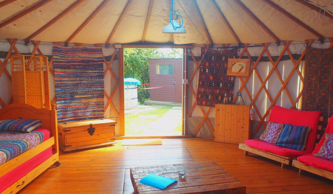 Panoramic view of inside of Yurt seating and sleeping area