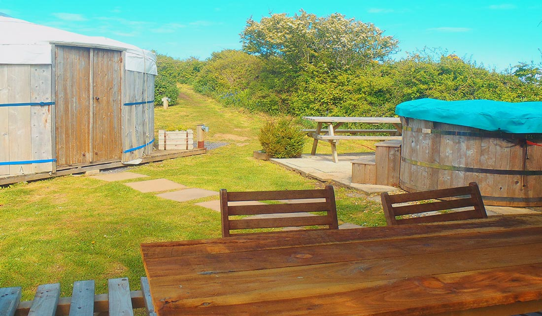 View of Seren Yurt pitch with hot tub