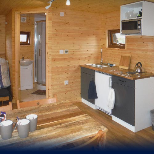 Shower, wash area and kitched inside the Eco Den