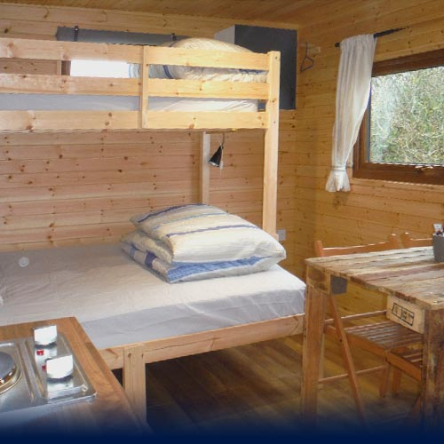 Bunk Beds and dining area inside the Eco Den